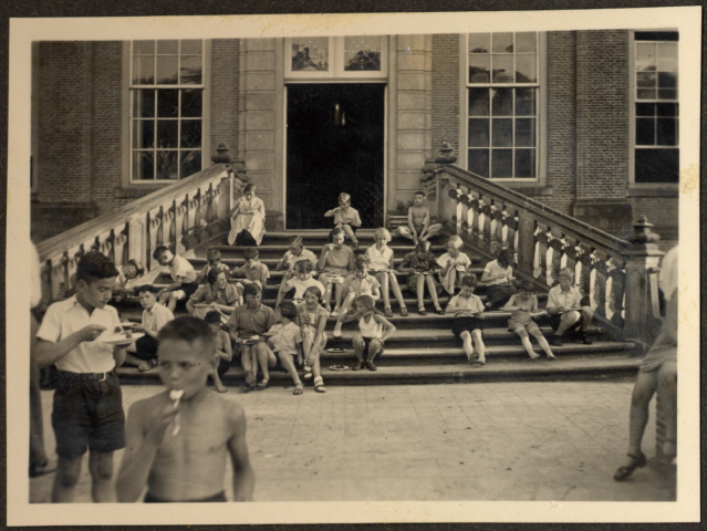 Children, many of them German Jewish refugees, relax on the steps of a Quaker boarding school in Eerde. (US Holocaust Memorial Museum, courtesy of Monica Lake)