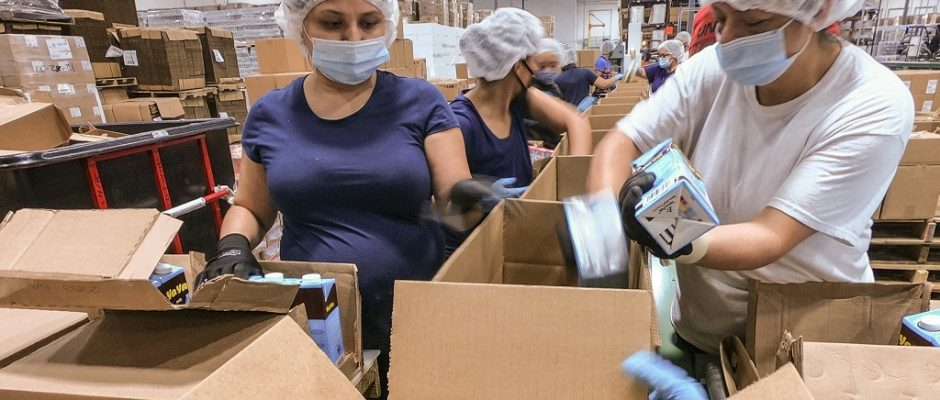"""USDA subcontract staff boxing multiple-week supplemental food boxes for children in rural locations,"" by Lance Cheung"